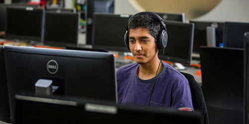 male student using a computer